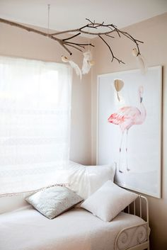 Branch suspended from ceiling in kids room. Oh, the possibilities!