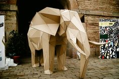 Elefab, a zip-tied, cardboard 3D puzzle elephant assembled at a Fab Kids workshop.