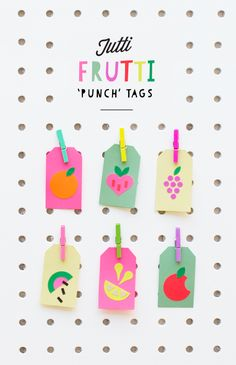 All you need to make these fruit-themed tags is colored paper and scissors.