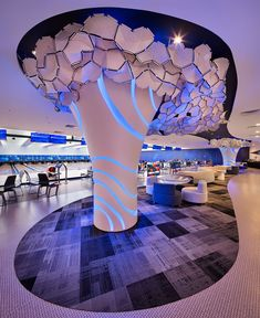 Orchid Bowl, bowling alley in Singapore by Kyoob-id. The tree-like structures are adorned by clusters of polygonal acoustic panels which reduce noise levels. Interior Design Institute, Interior Design Singapore, Interior Design Magazine, Interior Design Companies, Home Interior Design, Interior Architecture, Interior Decorating, Commercial Design, Commercial Interiors