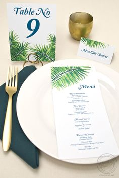 This palm frond suite is perfect for a beach or tropical destination wedding! I want to be tanning on the sand just looking at it. Matching menu cards, table numbers, place and escort cards. | Wedding Invitations by CharmCat Stationery & Design