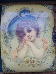 Early 1900's Victorian celluloid music box photo album, art by Frances Brundage (1854–1937)