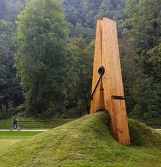Twitter / magur: Turkish artist Mehmet Ali Uysal puts a new spin on man's relationship with nature with his giant wooden clothes peg in Chaudfontaine Park in Belgium.