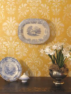 I love the sunny yellow color of this wall design. This stenciled design would be gorgeous in an entry and would make an elegant statement. What a great way to get the look of damask wallpaper without the commitment wallpaper requires.