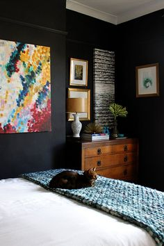 The white bedspread and warmth of the chest keep from being too strong!  hwk  8 Bold Paint Colors You Have to Try in Your Small Bedroom