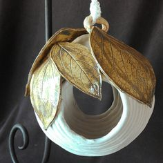 Hey, I found this really awesome Etsy listing at http://www.etsy.com/listing/158721316/hanging-coiled-ceramic-bird-house-or