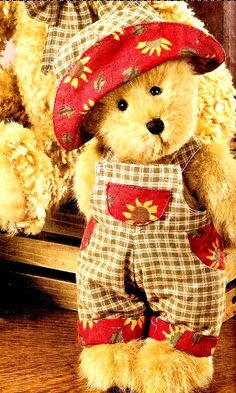 teddy bear dressed in gingham and daisies on red trim