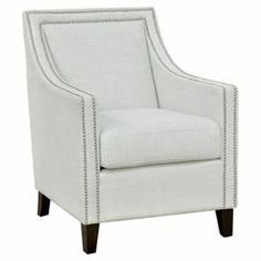 "With a streamlined silhouette and ivory upholstery, this birch wood arm chair offers a crisp canvas for a vibrant pillow and sumptuous wool throw.   Product: ChairConstruction Material: Birch wood and fabricColor: Black and ivoryFeatures: Nailhead trim Dimensions: 36"" H x 28"" W x 33"" D"