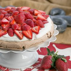 With its crisp shell and marshmallow interior, this Chocolate Pavlova with mascarpone cream and sweet ripe strawberries will thrill whoever gets a slice! #SundaySupper #GalloFamily