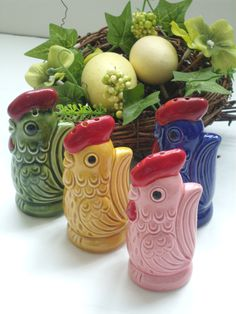 Vintage 60s Spring Chicken Hen Salt and Pepper Shakers - Set of 4 salt and pepper shakers - Green, blue, yellow and pink roosters. $11.00, via Etsy.