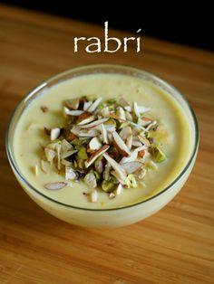 rabri recipe, rabdi recipe, how to make malpua rabdi with step by step photo/video. rabri sweet is evaporated sweet thick milk dessert consumed with malpua.