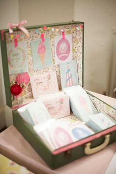darling display of art work/cards in vintage suitcase  {Charlotte Love}