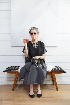 Stylish senior woman with her pet dog  by Trinette Reed for Stocksy United