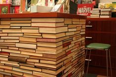 cash wrap created from stacks of old books around a cabinet