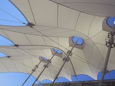 mast (center to peaks and cable rings in tensile structures)
