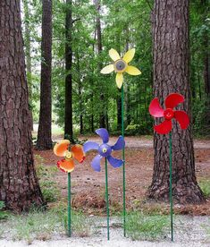 "Made from green metal pipes and old fan blades painted bright colors, these ""flowers"" spin slowly in the breeze.   https://www.flickr.com/photos/11921503@N00/16550936016/in/photostream/"