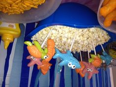 I made these sea creature pops out of Wilton candy melts, sea creatures mold, and candy eyes.