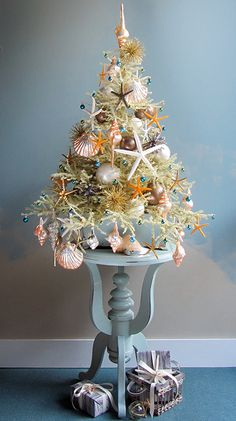 The Most Marvellous Mini Beach Christmas Trees by Tree Decorator Darryl Moland. Featured on Beach Bliss Living: http://beachblissliving.com/mini-beach-christmas-trees/