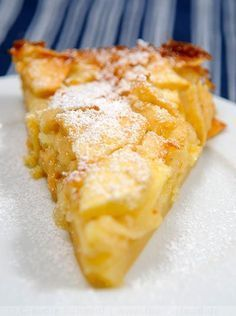 Torta di Mele; Toskanischer Apfelkuchen American conversion: 5 firm, tart apples Juice of one lemon 2 eggs 1 1/2 cups sugar 1 teaspoon vanilla 1/4 cup (half stick) butter, melted 1 cup flour 1 teaspoon baking powder 1/3 cup milk