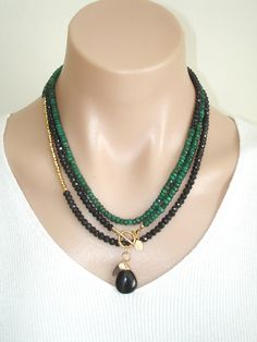 https://www.etsy.com/listing/112147011/ashira-black-spinel-and-natural-green? Ashira Black Spinel and Natural Green Emerald Gemstone Necklace with Charms. $485.00, via Etsy.