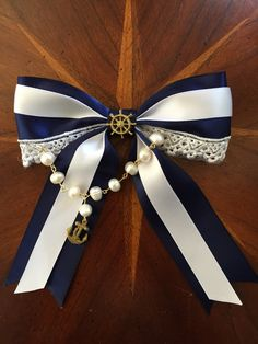 "My new bow! ""Hello Sailor!"" The rudder and anchor were made by me as well as the strand of pearls. #crafty #handmade #hairbows #hellosailor #missmbowtique #missmaegansbowtique  @missmbowtique"