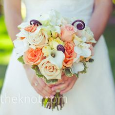 bouquet of roses and calla lilies had a little more white than the ones her bridesmaids carried. Hers also had fiddlehead ferns for a bit of whimsy.