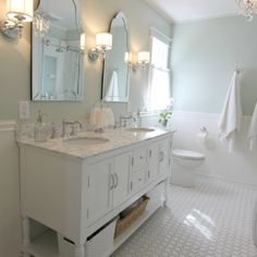 Golden Boys and Me did such a beautiful job on their bathroom renovation. It is painted Sherwin Williams Sea Salt, which I actually have in my own powder room. It's a great light grayish-bluish-greenish color. I also used those same mirrors in our hallway bathroom... #sherwinwilliamsseasalt