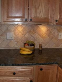 Kitchen Backsplash With Oak Cabinets oak cabinets w granite counters and stone tile backsplash, neutral