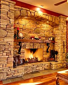 Would love to build a fire place mantel out of old timber and stone similar to this.