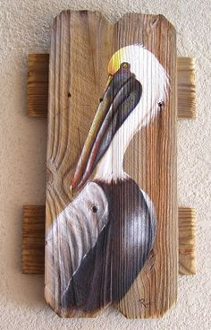 Handpainted pelican on weathered wood fence boards. Pelican is handpainted in acrylic paint in my Rose Artworks studio and then sealed with UV