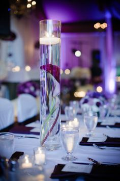 Simple but elegant centerpiece for a purple wedding