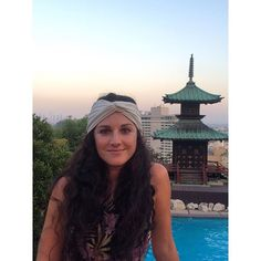 Summer nights at the Pagoda Bar wearing the current fave The Belize stretch turban it's cream with the perfect amount of gold shimmer  #SummerVibes #Yamashiro #Magic #Sunset #ImWithTheBandHeadbands