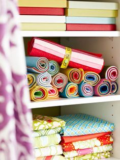 Contain rolls of felt or fabric using this quick and thrifty idea: Cut a fabric measuring tape to size and add a colorful snap. - bjl