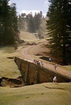 People climb on Bloody Bridge—which was built by penal colony prisoners—on Norfolk Island in Australia, 1960. Photograph by J. Baylor Roberts, National Geographic Creative