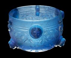 Roman Glass Cup with Medallions, From the Rhine Valley, C. 1st Half of the 4th Century AD  With six medallions depicting female faces. This may have been been used as a lamp.