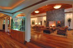 Ceiling mimics floor, aquarium, arched openings, soffit lighting.