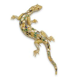 A WHIMSICAL MULTI-GEM, COLOURED DIAMOND AND DIAMOND LIZARD BROOCH, BY CARTIER