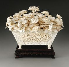 A large Chinese Carved Ivory Floral Planter.