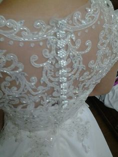 Back details of a wedding gown by EJ Relampagos