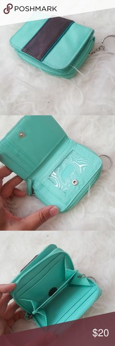 Turquoise wallet Holds 7 cards, 2 clear ID displays, and 2 coin/receipts sections Accessories
