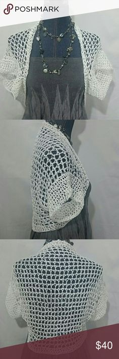 Hand Crocheted White Cotton Shrug Bolero This shrug is hand crocheted with two strands of 100% cotton thread. Not as soft as yarn but it's thinner and cooler!  This shrug is designed to only cover your shoulders, not your bust.  Made to wear over sleeveless tops and sundresses.  Short sleeve covers the top of your arm for those of us who don't want to show much arm.  The lacy design has some give but the thread itself is not stretchy.  This one fits a 14 loose so possibly may fit a 16. More…