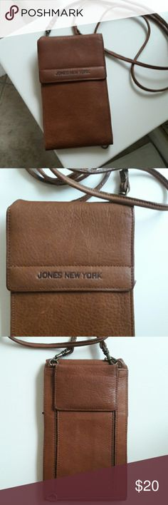 Crossbody Wallet Leather Jones New York Leather Wallet. Great preloved condition.  Strap can unclip. Lots of  storage for credit cards, cash, glasses, change, etc. Has slits, slides, zippered pockets inside and Velcro pocket outside on back. You will love this. Jones New York Bags Wallets