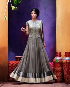 Grey Anarkali suit with embroidered yoke   1. Grey readymade anarkali suit is fabricated in net and tissue with a santoon lining. Crafted in hand work on yoke and sleeves, tissue yoke and piping on bottom and dupatta. 2. Comes with matching bottom and dupatta3. Sizes available: M, L, XL, XXL