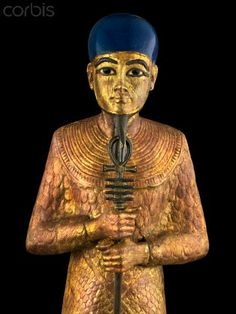 Statue of Ptah from tomb of Tutankhamun.... Notice the walking stick with the ankh...the same symbol used by the pope and Catholic Church hierarchy.