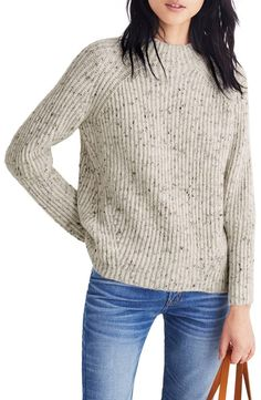 Tweedy flecks bring an earthy richness to this wool-infused sweater with cool, angled seams and wear-all-season versatility.