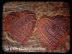 Two blackened wax ornie Valentine hearts spice rubbed for a lovely valentine display. By: Ye Olde Crow Primitives