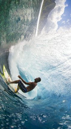 Michel 'The Spartan' Bourez, goes up against a mighty wave in his native Tahiti. Image:  Ben Thouard http://win.gs/NExz90 #surf #tahiti #michelbourez