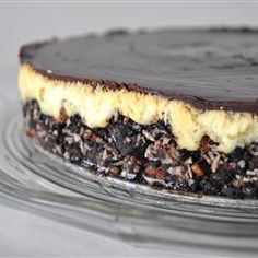 """Nanaimo Bar Cheesecake Canada Day Nanaimo Bar Cheesecake I """"Such a wonderful recipe to have. Tastes wonderful and pretty easy to make.""""Canada Day Nanaimo Bar Cheesecake I """"Such a wonderful recipe to have. Tastes wonderful and pretty easy to make. Nanaimo Bars, Cheesecake Bars, Cheesecake Recipes, Food Cakes, Cupcake Cakes, Cupcakes, Köstliche Desserts, Dessert Recipes, Bar Recipes"""