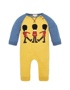 Brighten up his day with our guard sleepsuit, made in pure cotton. Fun and vibrant, it features blue marl sleeves, mock tortoiseshell buttons and London Guard appliqués with furry hats. Popper fastenings make for easy changing.