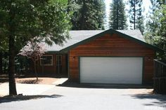 7223 Capps Crossing Rd, Grizzly Flats, CA 95636 — Beautiful Family Home on Private Setting. Very well constructed and lovingly cared for. Cedar Siding. Fantastic Deck. New Milguard Windows in 2011. Newer HVAC. Vaulted Ceilings. Newer Kitchen Appliances. Pull out Awning over Deck. Built in Generator. Garage Cabinets. Inside Laundry Room with Cabinets. The Garden is planted and fully fenced. RV or Boat Parking. Large Storage Shed. Storage Under House.